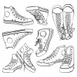 Black and white sneakers set — Stock Vector