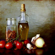 Stock Photo: Mediterranean flavours - olive oil, cherry tomatoes, dry peppers