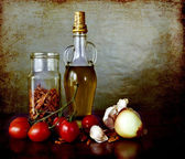 Mediterranean flavours - olive oil, cherry tomatoes, dry peppers — Stock Photo