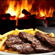 Roast beef with fries - Stock Photo