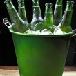 Ice bucket with beer — Stock Photo