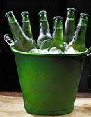 Ice bucket with beer — Stock Photo