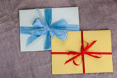 Two envelope sacking tied with ribbon — Stock Photo