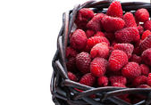 Raspberry in wood basket isolated on white — Stock Photo