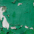 The texture on the wall of shabby green paint - Stock Photo