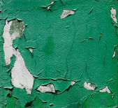The texture on the wall of shabby green paint — Stock Photo