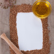 The composition of buckwheat and sunflower oil on canvas — Stock Photo