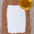 Frame made of buckwheat on canvas — Stock Photo