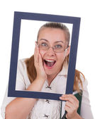 Business lady looks surprised through the frame — Stock Photo