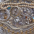 Variety of golden and silver jewels — Stock Photo