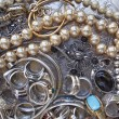 Stock Photo: Variety of golden and silver jewels