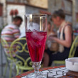 Stock Photo: Ice tewith grenadine syrup and chatting