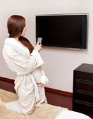 Attractive woman watching TV — Stock Photo