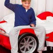 Stock Photo: Boy and his supercar bed with keys
