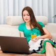 Stock Photo: Atractive womworking on her laptop
