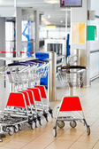 Airport security check point, luggage carts. — Stock Photo