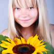 Girl with sunflower - Stock Photo