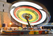 Fairground carousel blurred with motion — Stock Photo