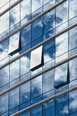 Sky and clouds reflected in windows of a building — Stock Photo