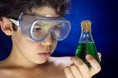 Boy looks scientific experiment — Stock Photo