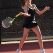 Stock Photo: Female Tennis Player Hits Forehand In Match