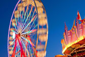 Ferris Wheel Motion Blurs At Dusk — Stock Photo