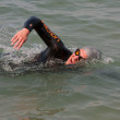 Stock Photo: Male Swimmer Swims Freestyle Stroke In Lake Michigan
