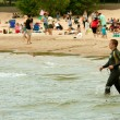 Stock Photo: Male Swimmer In Wetsuit Prepares To Swim Lake Michigan