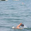 Stock Photo: Male Swimmer Swims Freestyle In Lake Michigan
