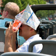 Tourist Takes Photos From Sightseeing Bus — Stock Photo #12033844