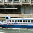 Постер, плакат: Water Taxi Transports Tourists Down Chicago River