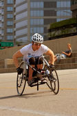 Female In Racing Wheelchair Works Out Along Chicago Asphalt — Stock Photo