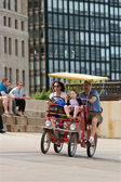 Tourist Family Pedals Four Wheeled Bike Along Lake Shore Drive — Stock Photo