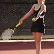 Stock Photo: Female Tennis Player Prepares To Serve