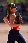 Female Softball Player Jogs Off Field In Between Innings — Stock Photo
