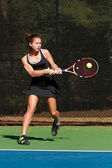 Female Tennis Player Hits Powerful Backhand Shot — Stock Photo