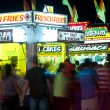 County Fair Patrons Move About Fast Food Vendors — Stock Photo