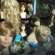 Wigs in a show window — Stock Photo