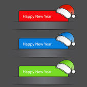 Vector Happy New Year 2012 Labels with santa hat — Stock Vector