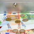 Stock Photo: Money and cashbox
