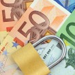 Royalty-Free Stock Photo: Padlock on Euro banknotes