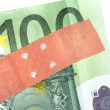 Stock Photo: Adhesive bandage on banknote