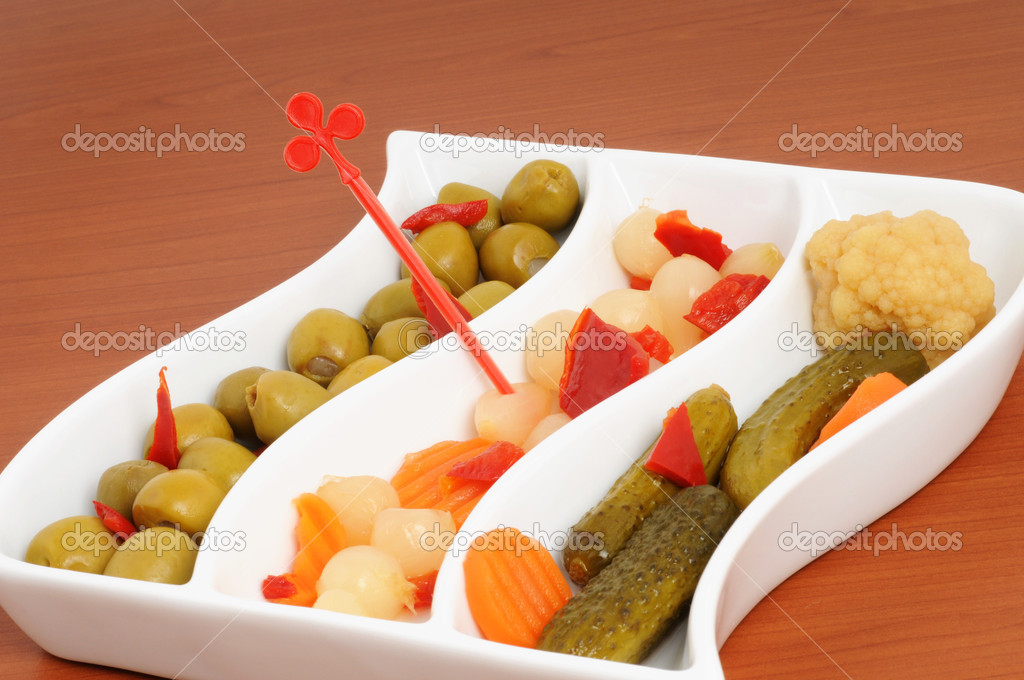 Cup with mixed pickles as appetizer — Stock Photo #11699587