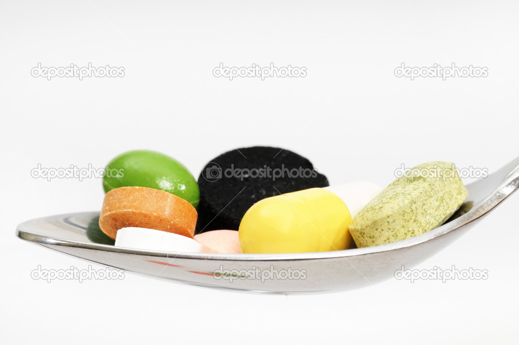 Medicine on a spoon in a studio shot — Stock Photo #11700017