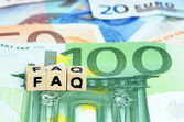Letters FAQ in wooden letters on Euro currency — Stock Photo