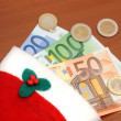 Santas hat with Euro money — Stock Photo
