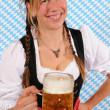 Stock Photo: Womwith BavariDirndl and beer stein