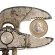Spanish Euro coin in rusty pliers — Stock Photo