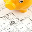 Stock Photo: Construction plan with piggy bank as symbol for building a house