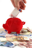 Piggy bank standing on Euro-banknotes — Stock Photo